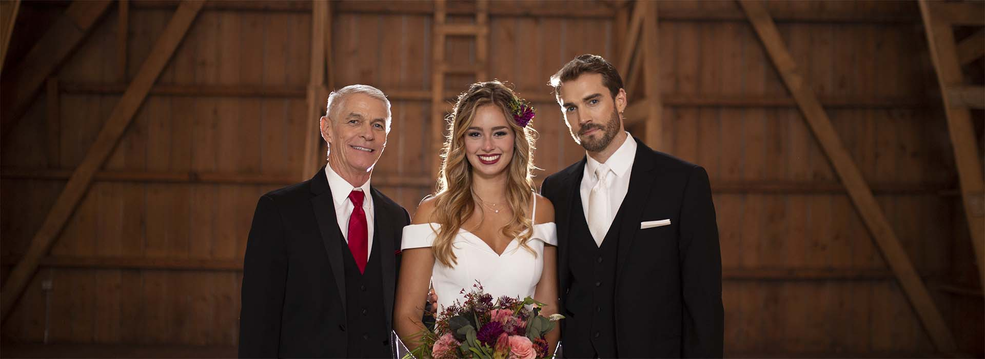 Bride with Groom and Father wearing black tuxedos