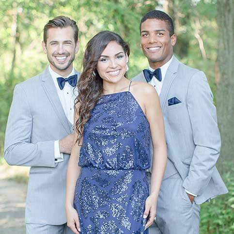 bridesmaid with two groomsmen in grey tuxedos