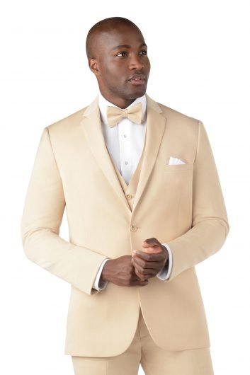 You man wearing a tan island suit by Michael Kors